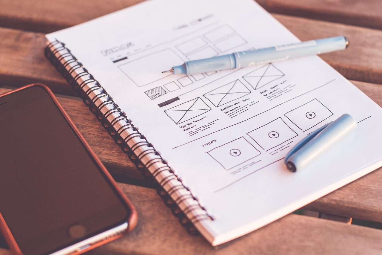 mobile device and sketch pad on table. website mockup on sketchpad - smyle webdesign websites mit WordPress in Plochingen